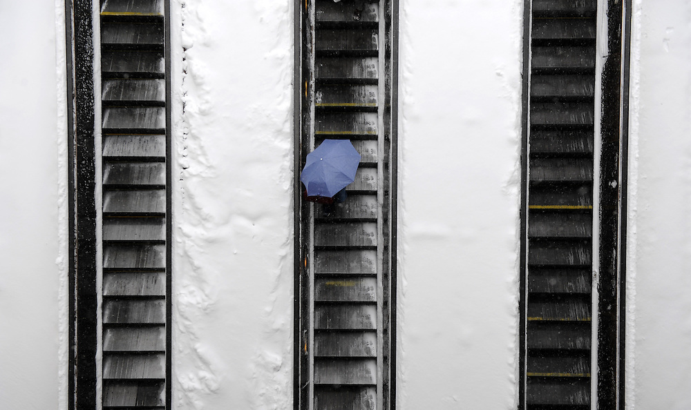 A commuter rides the escalator down into a Metro Train station in northwest Washington, DC, USA on 02 March 2009. A late winter storm is blanketing the Eastern US with as much as 8-12 inches of snow today.