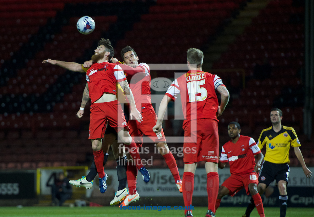 Romain Vincelot of Leyton Orient wins the header during the Capital One Cup match at the Matchroom Stadium, London<br /> Picture by Alan Stanford/Focus Images Ltd +44 7915 056117<br /> 23/09/2014