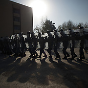 November 14, 2012 - Kabul, Afghanistan: Afghan National Police (ANP) cadets train riot control during morning exercises at the Afghan Nacional Police Academy...ANP Academy trains 1250 cadets at the time during a period of four years. Every year, five hundred new recruits are selected, out of more than nine thousand of candidates, to join the academy and other five hundred graduate. Fifteen per cent of the recruits are women. (Paulo Nunes dos Santos/Polaris)