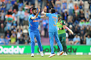 Jasprit Bumrah and Yuzvendra Chahal of India celebrate the wicket of Quinton de Kock during the ICC Cricket World Cup 2019 match between South Africa and India at the Hampshire Bowl, Southampton, United Kingdom on 5 June 2019.