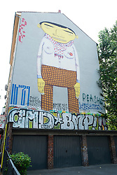 Street art painted on apartment building walls in bohemian district of Kreuzberg  in Berlin Germany