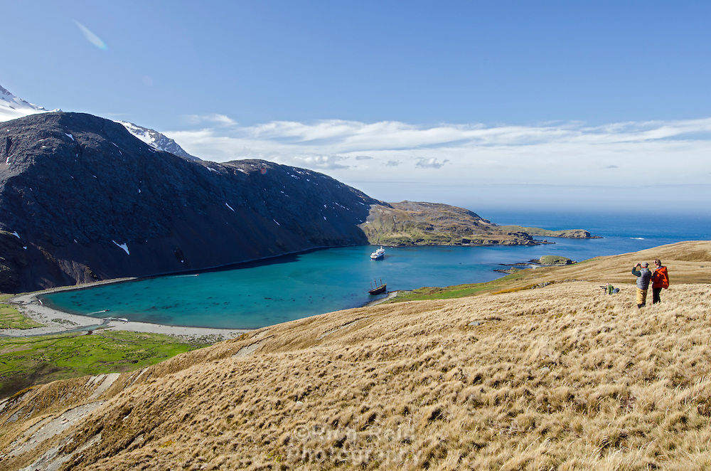 Hikers overlooking Ocean Harbour on South Georgia Island.