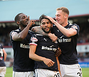 August 9th 2017, Dens Park, Dundee, Scotland; Scottish League Cup Second Round; Dundee versus Dundee United; Dundee's Faissal El Bakhtaoui is congratulated after scoring to make it 1-0 by Roarie Deacon and Kevin Holt