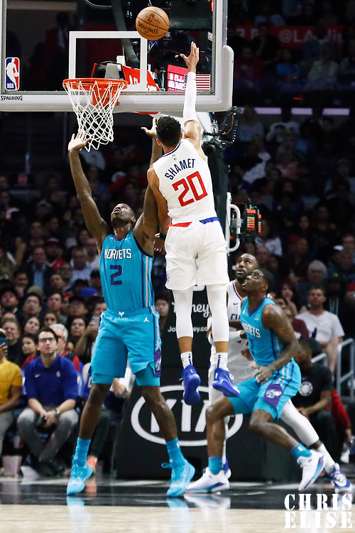 LOS ANGELES, CA - OCT 28: Landry Shamet (20) of the LA Clippers shoots the ball against Marvin Williams (2) of the Charlotte Hornets during a game on October 28, 2019 at the Staples Center, in Los Angeles, California.