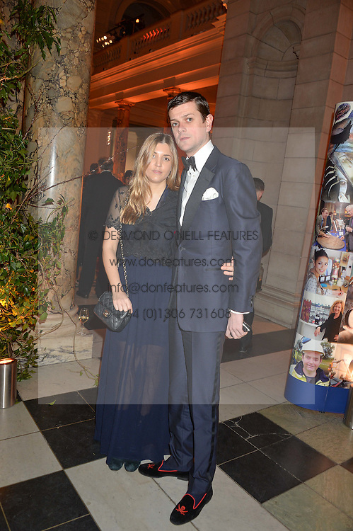 The HON.ALEXANDER SPENCER-CHURCHILL and SCARLETT STRUTT at the inaugural dinner for The Queen Elizabeth Scholarship Trust hosted by Viscount Linley at the V&A museum, London on 25th February 2016.