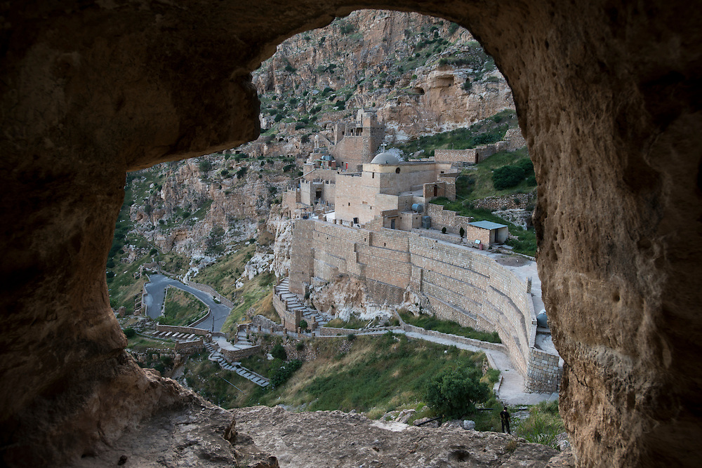 The 7th century Rabban Hermizd monastery carved into the mountainside overlooking the Nineveh Plain in Northern Iraq. Christianity came to the area in the first century AD and the Iraqi Christian community is thought to be one of the longest coninuous Christian communities in the world. Violence, persecution and sectarian strife have forced two thirds of Iraqi Christians to flee the country in recent years and many more to be displaced to the relative security of Iraqi Kurdistan. Al Qosh, Iraq. 19/04/2014.