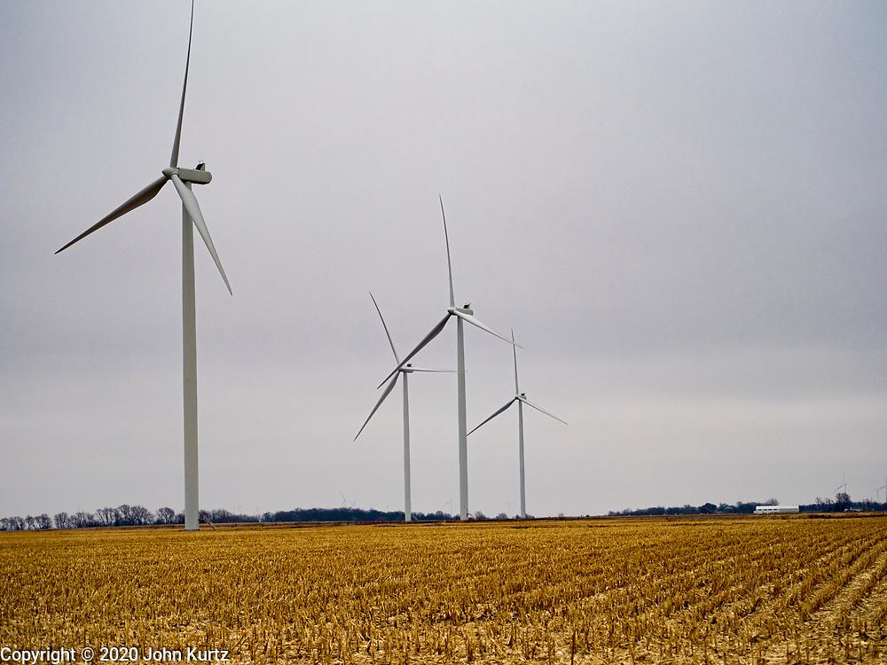 03 JANUARY 2020 - MONTEZUMA, IOWA: Wind turbines in farm fields along US Highway 63 near Montezuma, Iowa. Iowa is a leader in wind energy and generates about 35% of its electrical needs through wind turbines.       PHOTO BY JACK KURTZ