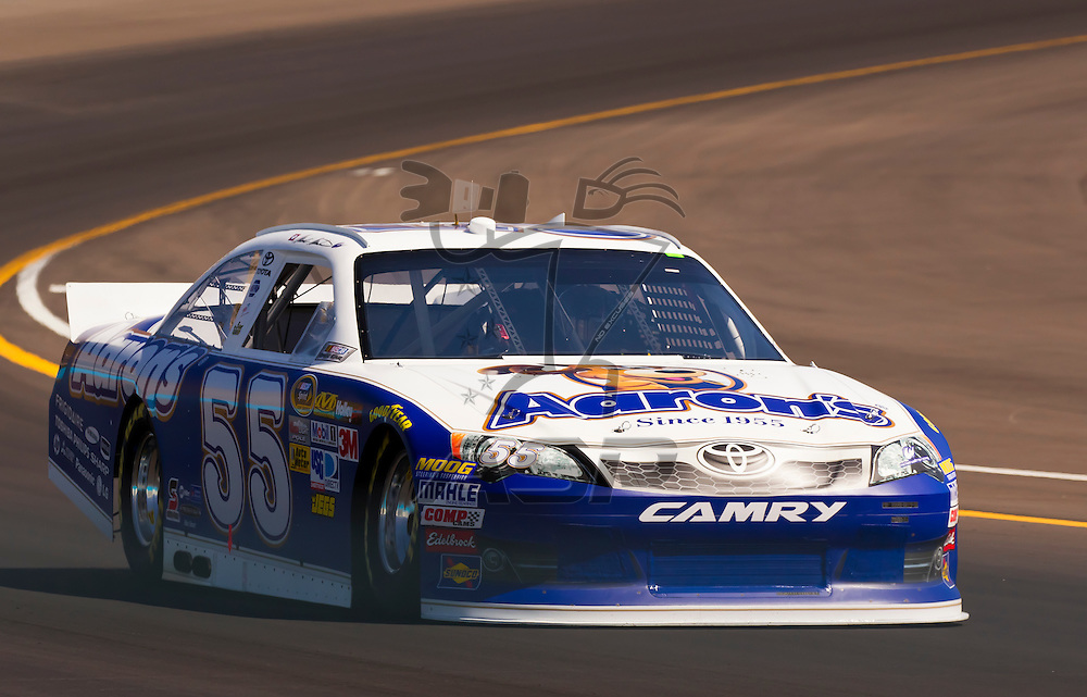 AVONDALE, AZ - MAR 03, 2012:  With a time of 26.313 seconds and a speed of 136.815, Mark Martin (55), takes the pole for Sunday's 8th Annual Subway Fresh Fit 500 NASCAR race at the Phoenix International Speedway in Avondale, AZ.
