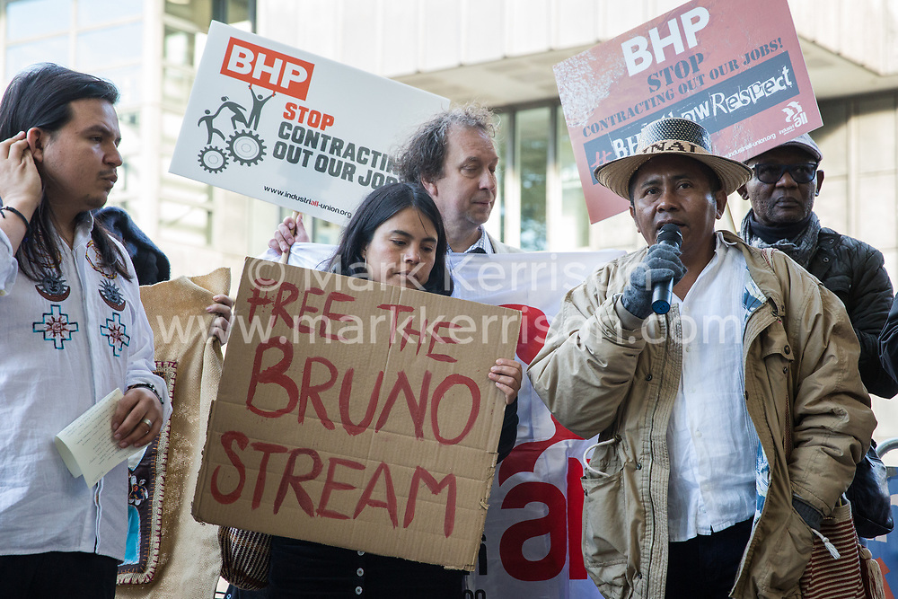 London, UK. 17 October, 2019. Alvaro Ipuana, a community leader from Nuevo Espinal, a community in Colombia affected by the Cerrejon opencast coal mine, which is part-owned by BHP, joins other frontline human rights defenders and climate justice activists from London Mining Network and War on Want in protesting outside the AGM of British-Australian mining company BHP at the QEII Centre against the company's destructive mining practices, which are contributing to climate breakdown across the globe.