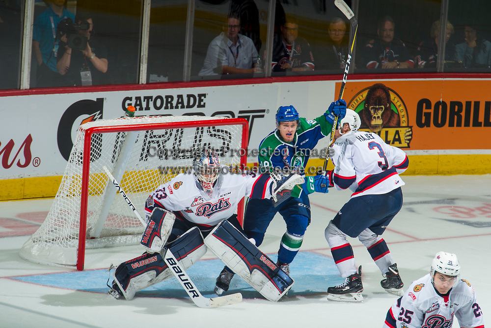 REGINA, SK - MAY 23: Beck Malenstyn #19 of the Swift Current Broncos calls for the pass as Libor Hájek #3 skates in for the check in front of the net of Max Paddock #33 of the Regina Pats at the Brandt Centre on May 23, 2018 in Regina, Canada. (Photo by Marissa Baecker/CHL Images)