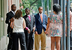 09 July 2014. New Orleans, Louisiana. <br /> Former mayor of New Orleans Ray Nagin's family including wife Seletha Smith, daughter Tianna and sons Jeremy and Jarin are met by Nagin's religious advisers outside Nagin's attorney's office following Ray Nagin's sentencing hearing. Ray Nagin was sentenced to serve 10 years in prison for bribery and money laundering. <br /> Photo; Charlie Varley/varleypix.com