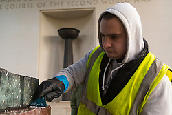 Specialist clean-up workers use high pressure steam and scrapers to clean the paint vandals squirted over the Bomber Command Memorial in Green Park in the early hours of Monday 21 January. The operation is expected to take at least a day. London, January 22 2019.