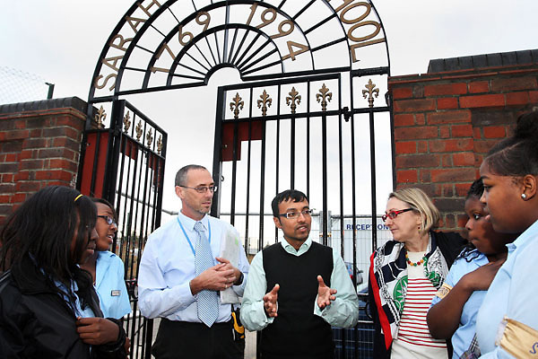 Farhan Zakaria with headteacher Cauthar Tooley and assistant head Mike Richardson at Sarah Bonnell School, Stratford, London. Mr. Zakaria is threatened with deportation..This picture: with well-wishing students outside the school gates. The teacher is evidently very popular with students..Pics: Jonathan Goldberg.
