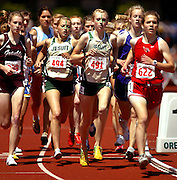 05/23/2009 - Franklin's Julia Fonk (338) runs off the shoulder of Jesuit's Payton Schutte (494) and teammate Annamarie Maag (491) with Lincoln's Betsy Kolberg (622) inside during the 6A Girl's 1500 Meter Run. The 2009 OSAA/U.S. Bank/Les Schwab Tires 6A-5A-4A Track and Field State Championships were run at Hayward Field in Eugene, Oregon.....KEYWORDS:  City, Portland, sports, Oregon, high school, OSAA, boys, girls, PIL, run, University, team