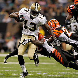 2009 August 14: New Orleans Saints wide receiver Rod Harper (13) runs after a catch away from Cincinnati Bengals defenders during 17-7 win by the New Orleans Saints over the Cincinnati Bengals in their preseason opener at the Louisiana Superdome in New Orleans, Louisiana.