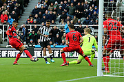 Kenedy (#15) of Newcastle United passes the ball across the front of goal for Ayoze Perez (#17) of Newcastle United to score Newcastle United's first goal (1-0) during the Premier League match between Newcastle United and Huddersfield Town at St. James's Park, Newcastle, England on 31 March 2018. Picture by Craig Doyle.