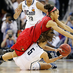 Apr 9, 2013; New Orleans, LA, USA; Connecticut Huskies guard Caroline Doty (5) is defended by Louisville Cardinals guard Bria Smith (21) during the first half of the championship game in the 2013 NCAA womens Final Four at the New Orleans Arena. Mandatory Credit: Derick E. Hingle-USA TODAY Sports