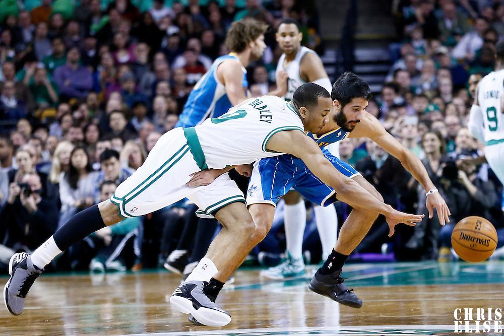 16 January 2013: Boston Celtics point guard Avery Bradley (0) steals the ball from New Orleans Hornets point guard Greivis Vasquez (21) during the New Orleans Hornets 90-78 victory over the Boston Celtics at the TD Garden, Boston, Massachusetts, USA.