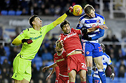 Reading forward Jon Daoi Boovarsson (23) is challenged by Nottingham Forest goalkeeper Costel Pantilimon (1) and defender Claudio Yacob during the EFL Sky Bet Championship match between Reading and Nottingham Forest at the Madejski Stadium, Reading, England on 12 January 2019.