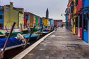 Canal passes between colorful houses