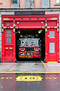 FDNY - Fire Department of the City of New York - Squad Company 18 fire engine truck in depot at West 10th Street in New York City West Village, USA