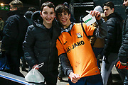 A very happy young fan got a Captain's armband and his shirt signed by Barnet defender Craig Robson (6) after The FA Cup fourth round match between Barnet and Brentford at The Hive Stadium, London, England on 28 January 2019.