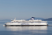 The BC Ferries vessel Spirit of British Columbia crosses the Strait of Georgia between mainland Canada and Vancouver Island. The Gulf Islands are visible in the background. BC Ferries, the common name for British Columbia Ferry Services Inc., is the largest passenger ferry system in North America and the second-largest in the world. It is a Crown corporation, owned by the Canadian government.