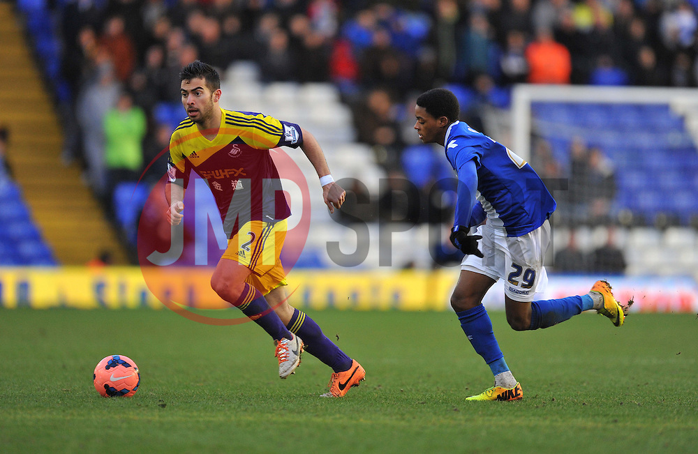 Swansea City's Jordi Amat gets chased down by Birmingham City's Reece Brown - Photo mandatory by-line: Alex James/JMP - Tel: Mobile: 07966 386802 25/01/2014 - SPORT - FOOTBALL - St Andrew's - Birmingham - Birmingham City v Swansea City - FA Cup - Forth Round