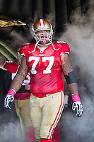 30 October 2011: Guard (77) Mike Iupati of the San Francisco 49ers stands in the helmet bubble during player introductions before the 49ers 20-10 victory against the Cleveland Browns in an NFL football game at Candlestick Park in San Francisco, CA.