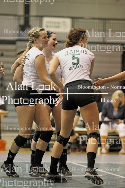 21 September 2013:  Lizzy Hawk, Erin Wachtel, Maddie Greybar during an NCAA women's division 3 Volleyball match between the Lincoln Christian University Lady Lynx and the Illinois Wesleyan  University Titans in Shirk Center, Bloomington IL