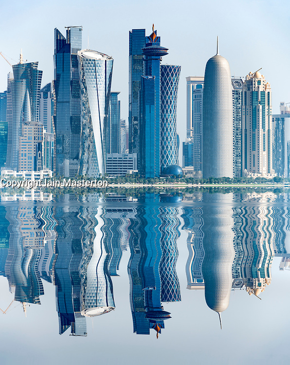 View along waterfront of Corniche towards modern office towers in West Bay financial and business district in Doha Qatar