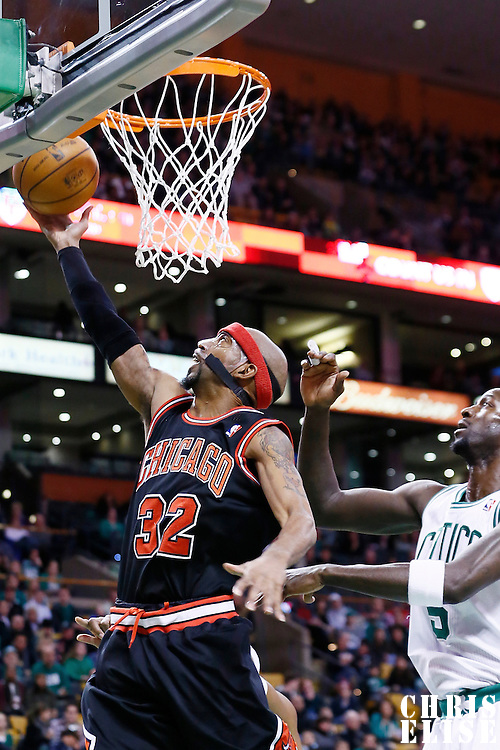 18 January 2013: Chicago Bulls shooting guard Richard Hamilton (32) goes for the layup past Boston Celtics power forward Kevin Garnett (5) during the Chicago Bulls 100-99 overtime victory over the Boston Celtics at the TD Garden, Boston, Massachusetts, USA.