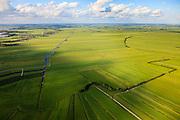 Nederland, Zuid-Holland, Gemeente Bodegraven, 15-07-2012; Noorzijderpolder  (voorgrond) en Meijepolder, veenweidegbied tussen Bodegraven en Meije. Het landschap is ontstaan door het ontginnen van het veen (cope-ontginning). De Noordzijdskade (met bomen in de voorgond) is een zogenaamde achterkade, scheiding tussen wel en niet ontgonnen veen.  Links de Dwarswetering..This polder and bog meadows area was created by the extraction of peat (land reclamation)..luchtfoto (toeslag), aerial photo (additional fee required).foto/photo Siebe Swart