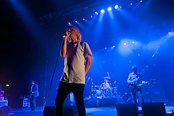 """© Licensed to London News Pictures. 08/06/2012. London, UK. The Charlatans perform live at Hammersmith Apollo, playing their 1997 and fifth studio album """"Telling' Stories"""" in its entirety.  In this picture L to R -  Martin Blunt, Tim Burgess, Jon Brookes, Mark Collins.   Photo credit : Richard Isaac/LNP"""