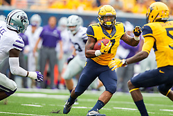 Oct 1, 2016; Morgantown, WV, USA; West Virginia Mountaineers running back Rushel Shell (7) runs the ball during the first quarter against the Kansas State Wildcats at Milan Puskar Stadium. Mandatory Credit: Ben Queen-USA TODAY Sports