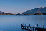 A view over Derwent Water and the jetty at Ashness Landing toward Skiddaw in the Lake District National Park, Cumbria, UK