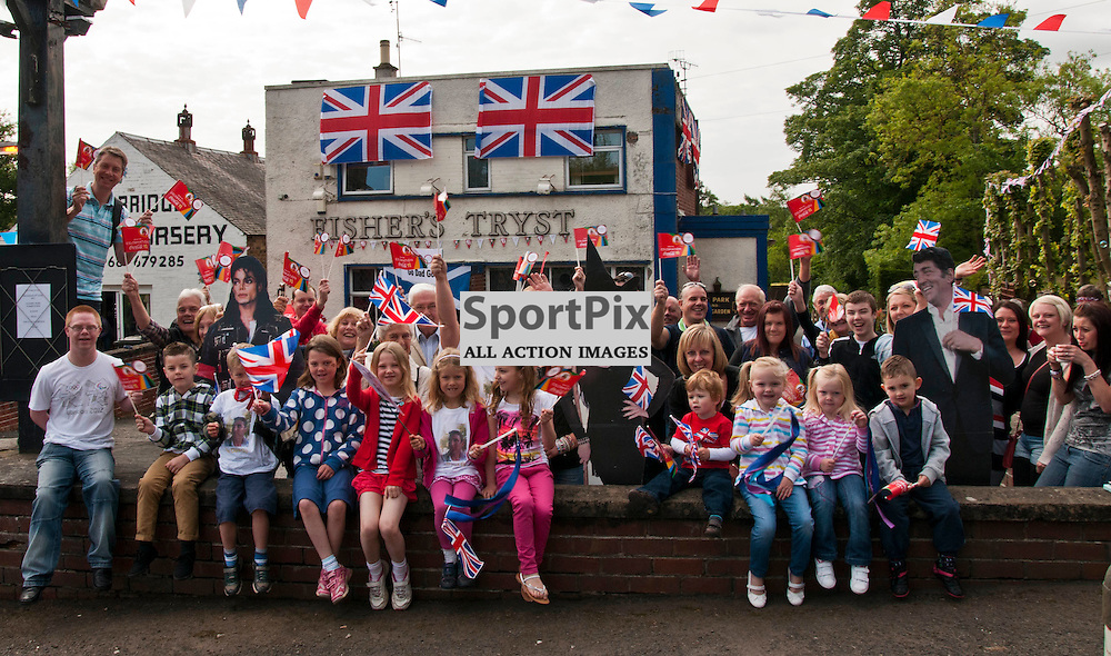 The Fisher's Tryst opend early to feed the crowds waiting for Day 27 of the Olympic Torch relay and the carnival continues it's travel to London heading through Milton Bridge and Penicuik in Midlothian. 14 June 2012 (Ger Harley | STOCKPIX)