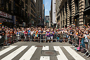 New York, NY - 25 June 2017. New York City Heritage of Pride March filled Fifth Avenue for hours with groups from the LGBT community and it's supporters. Spectators on W. 32d Street waiting for the marchers to come by.