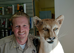 Shasta region of Northern California: Stuffed mountain lion and ranger at Castle Crags state park..Photo copyright Lee Foster.  Photo # california-castle-crags-cashas105162