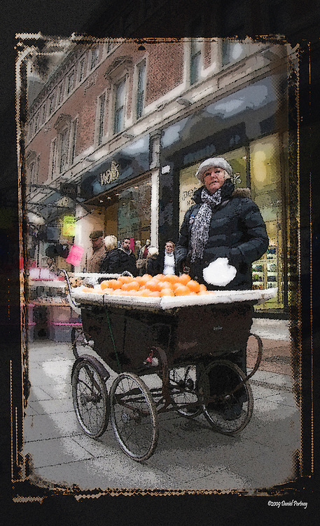 Street hawker oranges in baby carriage Dublin