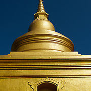 Golden Stupa at Wat Phra Singh in Chiang Rai, Thailand...Wat Pra Singh is located on Thanon Singkhlai in Tambon Wiang, Mueang district, Chiang Rai Province, northern Thailand..Wat Pra Singh was built by Pra Chao Maha Proma (P.E. 1345 ? 1400), circa 1385 (B.E. 1928).