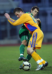 Ales Majer (2)  of Slovenia vs Silviu Ilie of Romania  during Friendly match between U-21 National teams of Slovenia and Romania, on February 11, 2009, in Nova Gorica, Slovenia. (Photo by Vid Ponikvar / Sportida)