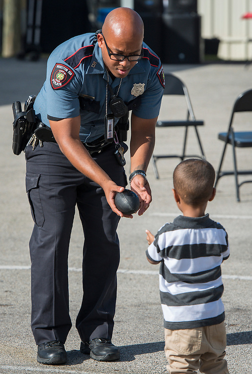 Houston ISD staff, vendors and community members participate in National Night Out activities at the Houston ISD Police Department, October 7, 2014.