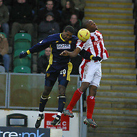 Photo: Jo Caird, Digitalsport<br /> Wimbledon v Stoke city<br /> Milton Keynes<br /> Nationwide Div One 2004<br /> 18/01/2004.<br /> <br /> MIKELE LEIGERTWOOD AND GIFTON NOEL-WILLIAMS compete