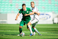 Filip Valencic of Olimpija vs Danijel Dezmar #17 of Krka during football match between NK Olimpija and NK Krka in Round 1 of Prva liga Telekom Slovenije 2014/15, on July 19, 2014 in SRC Stozice, Ljubljana, Slovenia. Photo by Vid Ponikvar / Sportida.com