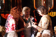 """Tamra Francis (left) helps get audience memebers ready for a fashion show during Mayhem & Mystery's production of """"Fashion Friction"""" at the Spaghetti Warehouse in downtown Dayton, Monday, March 21, 2011."""