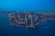 A helicopter view of Manhattan at dusk taken from a helicopter over New York Harbor.