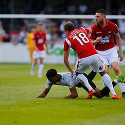 AUGUST 12:  Dover Athletic against Wrexham in Conference Premier at Crabble Stadium in Dover, England. Wrexham's defender Kevin Roberts brings Dover's forward Kane Richards to ground. (Photo by Matt Bristow/mattbristow.net)