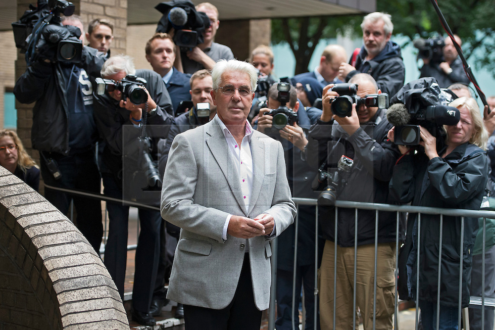 © London News Pictures. 04/10/2013. London, UK.  Publicist Max Clifford arriving at Southwark Crown Court in London where he pleaded not guilty to 11 counts of indecent assault allegedly committed between 1966 and 1985 relating to seven alleged victims, ranging in age from 14 to 19. Photo credit: Ben Cawthra/LNP