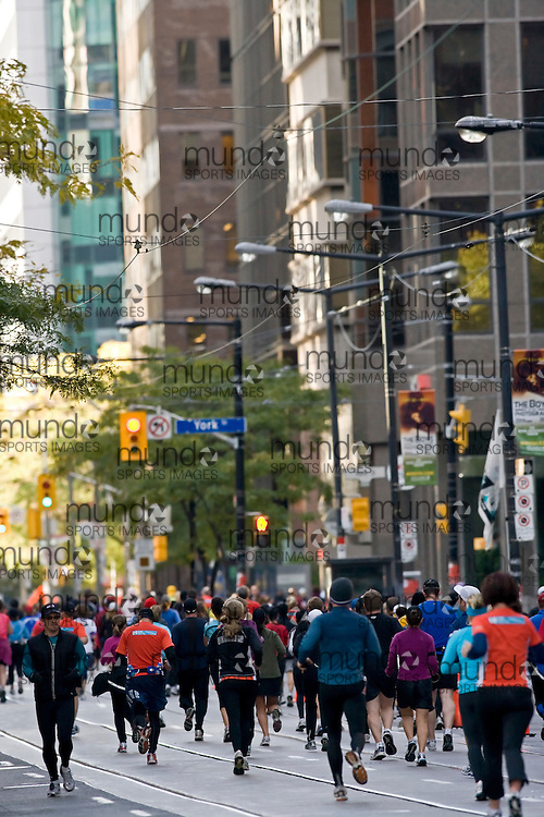 "(Toronto, Ontario -- 18 Oct 2009) Runners in the Goodlife Fitness Toronto Half-Marathon make their way along Wellington Street in the heart of the Toronto Business district. [Photo credit should read ""Sean Burges / Mundo Sport Images""]"